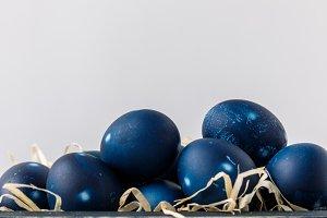 blue painted easter eggs on decorati