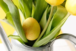 yellow painted easter egg in bouquet