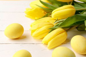 yellow painted easter eggs with bouq