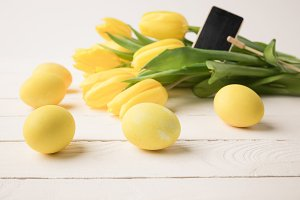 yellow painted easter eggs with tuli