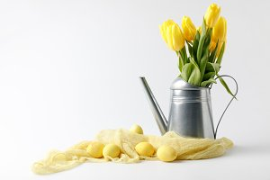 yellow painted easter eggs and tulip