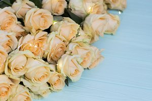 Peach roses on wooden turquoise