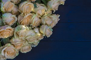 Peach roses on a wooden black