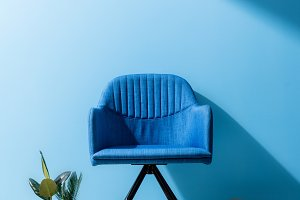 comfy blue armchair with person hold