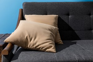 close-up shot of pillows lying on co