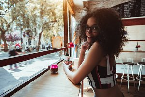 Brazilian curly girl in the bar