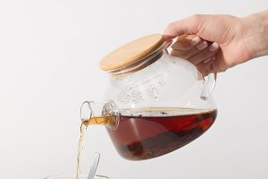 cropped shot of person pouring tea f