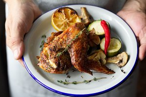 plate of baked chicken, lemon