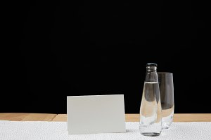 Bottle with water and empty glass on