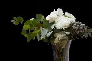 Tender flowers in vase with burning