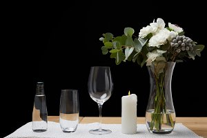 Bouquet in vase with water bottle an
