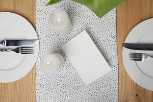 Dinnerware with cutlery on table nex