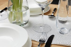 Dinnerware with glasses on table nex