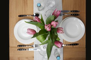 Dinnerware with plates on table with