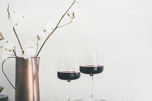 Two glasses of red wine over rustic