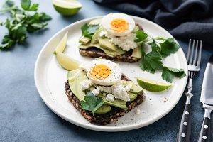 Healthy rye toast with avocado, egg