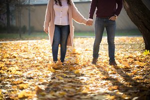 A cute couple walking in autumn park