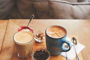 Hot coffee drinks in glass and cup w