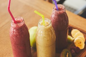Bottles with smoothies from fresh fr