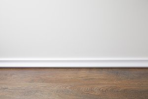 white wall and wooden floor in apart