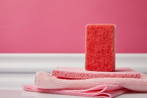 pink washing sponge and rags for spr
