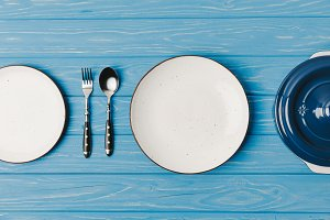 top view of fork, spoon and plates o