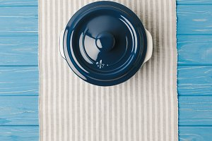 top view of pan on napkin on blue wo