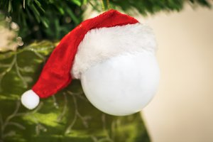 White  ball with Santa Claus hat