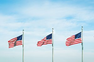 Group of five American flags waving