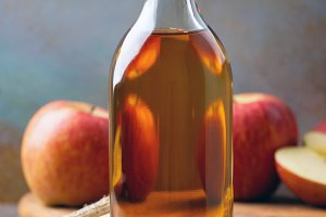 Apple vinegar. Bottle of apple organ