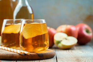 Organic Apple cider or juice on a wo