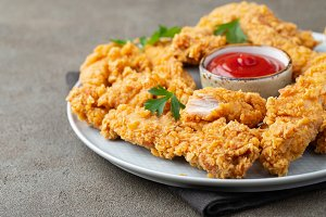 Breaded chicken strips with tomato k