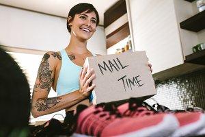 Female vlogger making mail time vlog