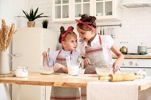 funny children preparing the dough