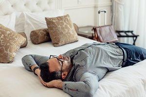 Tired businessman sleeping