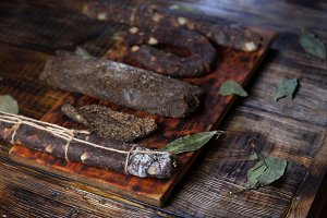 Dried meat on the kitchen board.