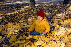 boy in a yellow jacket and a red