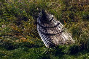 old wooden rowing boat lying in the