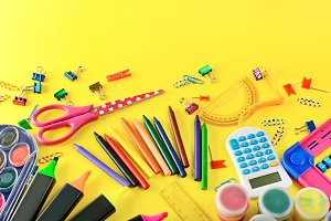 Set of school supplies on yellow bac