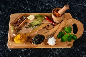 Top view of spices and herbs on kitc