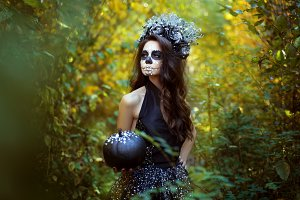 Young woman in Halloween costume.
