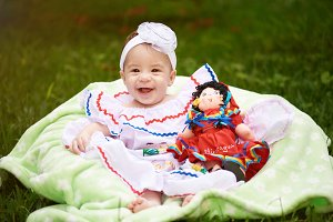Happy smiling girl with doll
