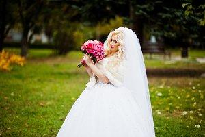 Portrait of charming blonde bride in