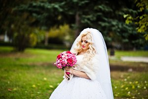 Portrait of charming blonde bride in
