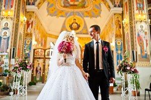 Stylish  wedding couple at church