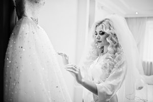 Young beautiful blonde bride looking