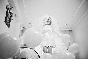 Young sexy blonde bride having fun a