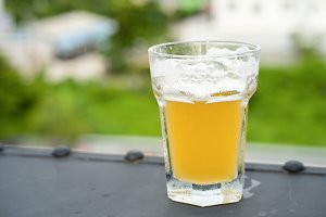 Beer glass on bokeh background