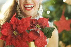 smiling trendy woman with red poinse