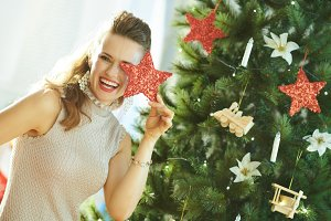 smiling woman playing with Christmas
